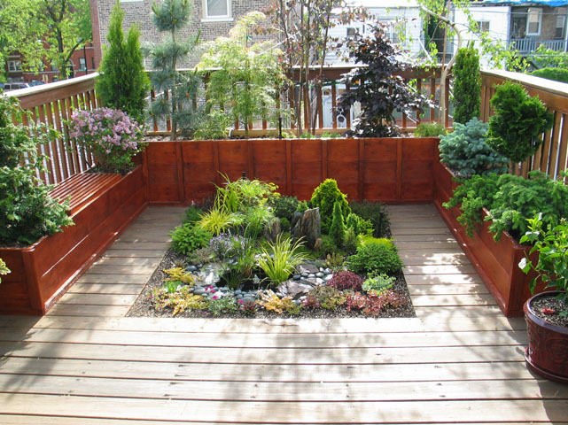 Rooftop Deck With Custom Planters Stone Hardscaping In Chicago - Rooftop landscaping