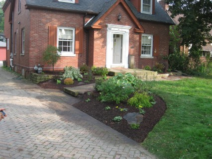 Front of house after we cleaned and installed new plants