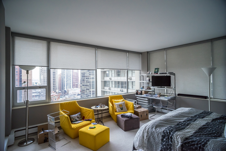 This client's yellow chairs really pop against the gray backdrop chosen for the walls of their bedroom.