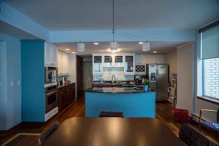 We painted a blue accent wall, white upper cabinets and installed a new tile backsplash for this kitchen.
